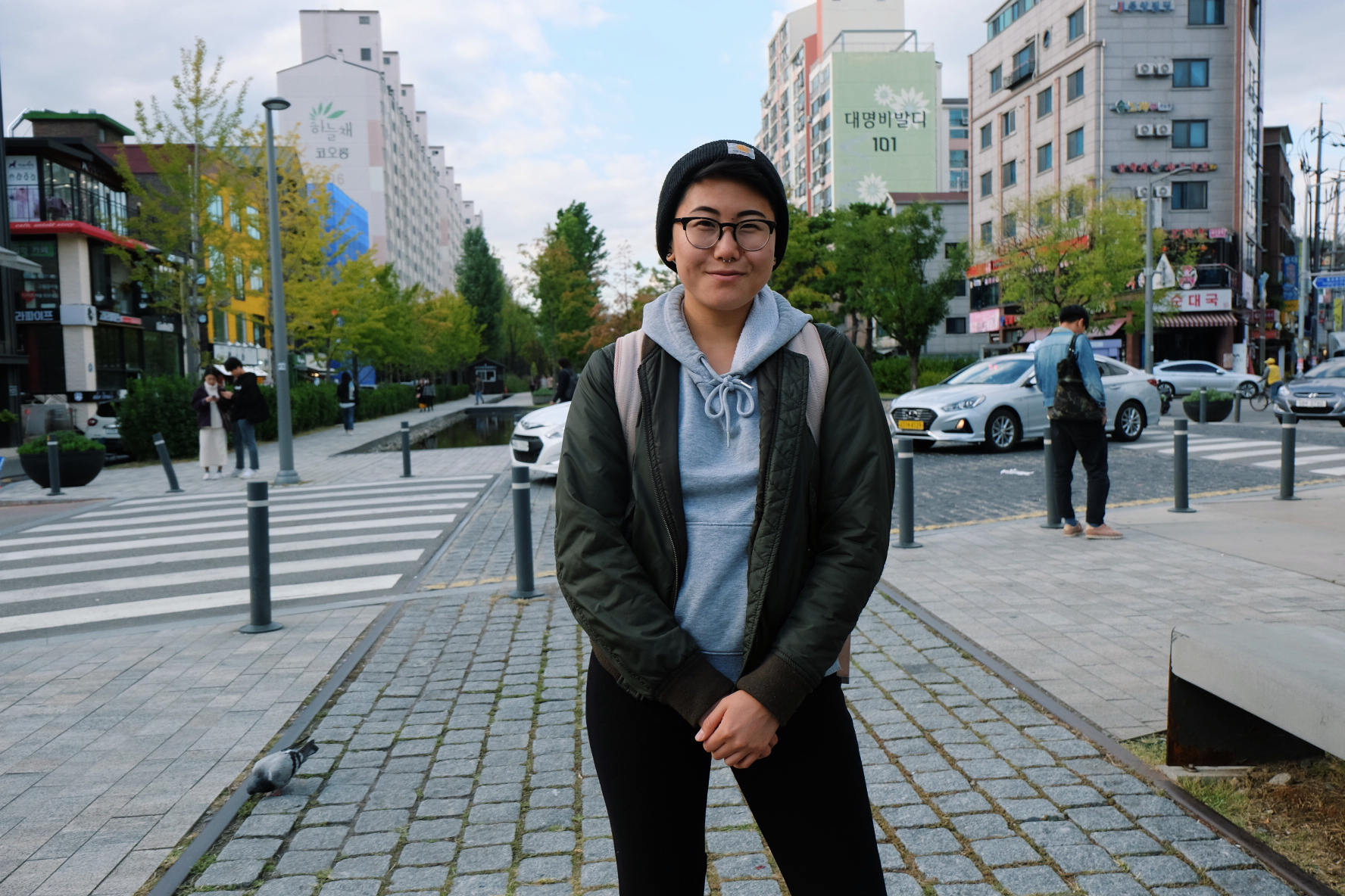 Photo of Tori Hong standing in a city.