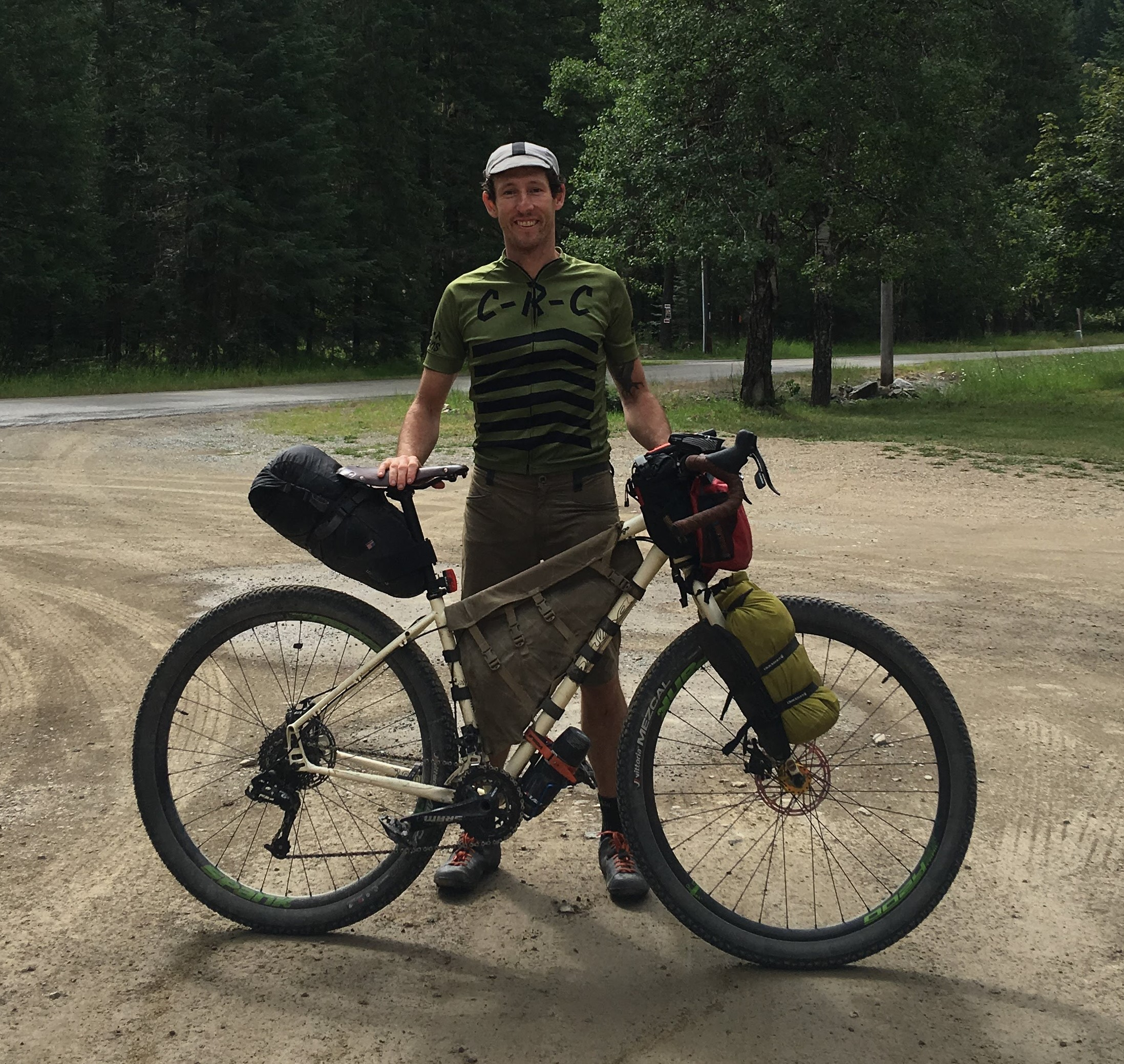 Todd Hunter stands with his bike